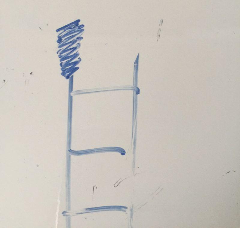 ホワイトボード上で固まったインクを同じマーカーペンで塗りつぶす