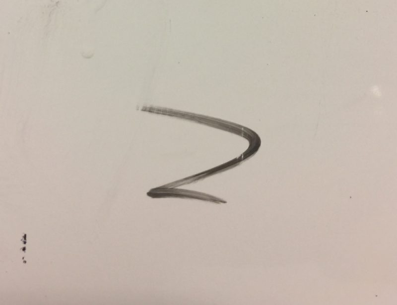 中性洗剤を使って油性ペンのインクを落とした様子